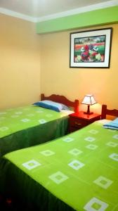 A bed or beds in a room at Residencial Norandes