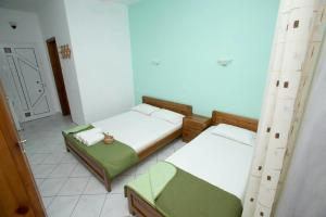 A bed or beds in a room at Gramatiki House