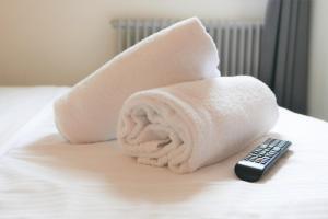 Ein Bett oder Betten in einem Zimmer der Unterkunft easyHotel Zürich City Centre