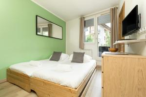 A bed or beds in a room at Apartment Lognan 1
