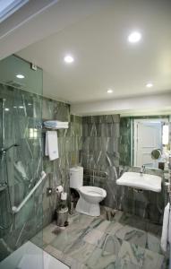 A bathroom at Hera Hotel