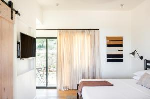 A bed or beds in a room at Contigo Ranch