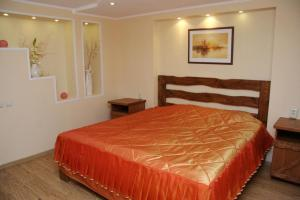A bed or beds in a room at Usadba Hotel