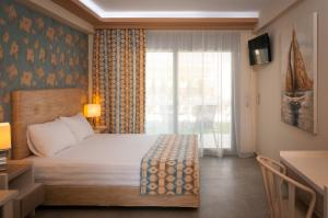Ένα ή περισσότερα κρεβάτια σε δωμάτιο στο KalyBay