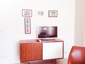A television and/or entertainment center at Angela's Apartment
