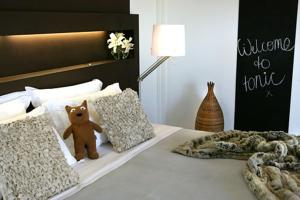 A bed or beds in a room at Tonic Hotel