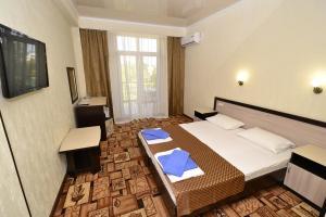 Кровать или кровати в номере Гостевой дом Эллада