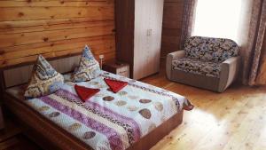 Кровать или кровати в номере Гостевой дом Удачный