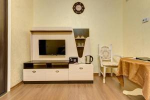 Телевизор и/или развлекательный центр в Отель Александрия