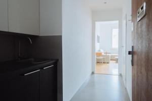 A kitchen or kitchenette at Perfect Days Apartments