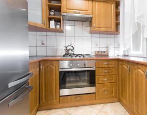 A kitchen or kitchenette at Apartament dla Ciebie 2