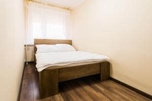 A bed or beds in a room at Apartament dla Ciebie 2