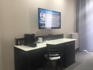 Een TV en/of entertainmentcenter bij Cour St Georges