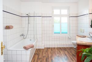 Ein Badezimmer in der Unterkunft Uferpromenade