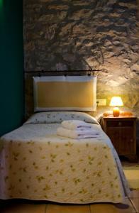 Una cama o camas en una habitación de Casa Cal Pastor