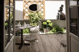 Ein Restaurant oder anderes Speiselokal in der Unterkunft Hotel Bristol Salzburg