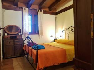Letto o letti in una camera di Villa Su Trechesu