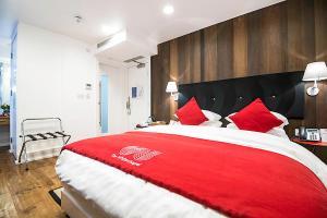 Кровать или кровати в номере The Whitechapel