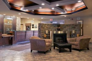 The lobby or reception area at Ramada by Wyndham Drumheller Hotel & Suites