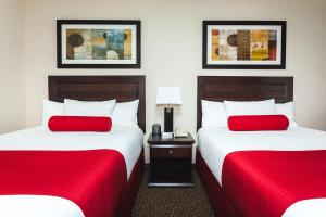 A bed or beds in a room at Century Casino & Hotel Edmonton