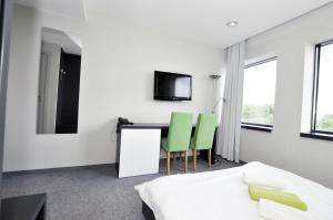 Telewizja i/lub zestaw kina domowego w obiekcie Sobotel Hotel & SPA