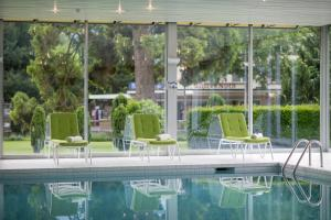 The swimming pool at or near Lindner Grand Hotel Beau Rivage