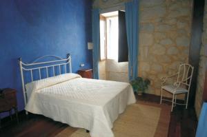 Cama o camas de una habitación en Pazo Da Escola