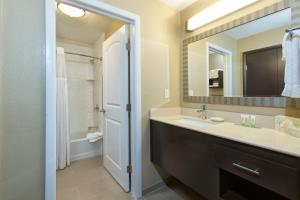 A bathroom at Staybridge Suites Orlando at SeaWorld