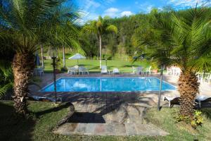 A piscina localizada em Fazenda Alvorada ou nos arredores
