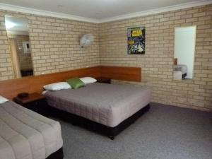 A bed or beds in a room at Lismore Wilson Motel