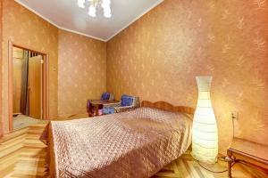 Кровать или кровати в номере Апартаменты Longo на Жуковского 18