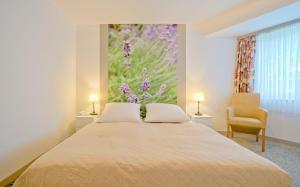 Ein Bett oder Betten in einem Zimmer der Unterkunft Hotel Havel Lodge Berlin
