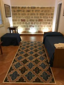 A bed or beds in a room at Dimora Tipica
