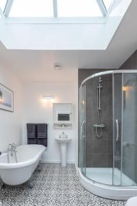 A bathroom at Clarence House Apartments