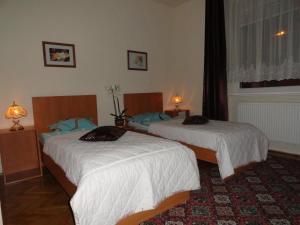 Łóżko lub łóżka w pokoju w obiekcie Villa Maria