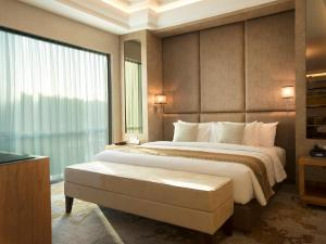 A bed or beds in a room at Best Western Premier Panbil
