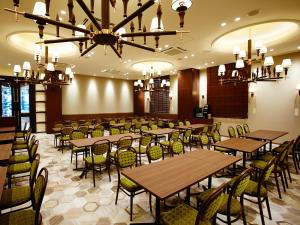 A restaurant or other place to eat at S.Training Center Hotel Osaka