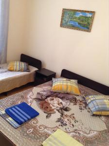A bed or beds in a room at Guest house Shtil
