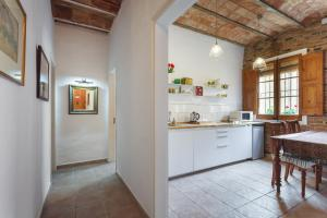 A kitchen or kitchenette at The Patio Barcelona