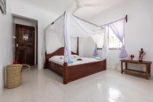A bed or beds in a room at Kite&Active Guesthouse