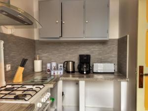 Cuisine ou kitchenette dans l'établissement Villa Yvonnette