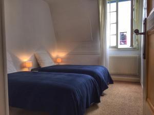 Un ou plusieurs lits dans un hébergement de l'établissement Villa Yvonnette