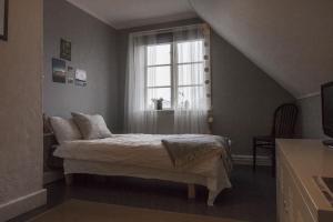 Säng eller sängar i ett rum på Ett Kvarter