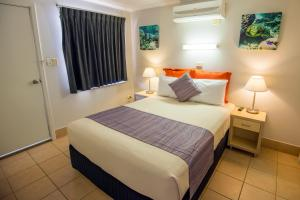 A bed or beds in a room at Ningaloo Reef Resort