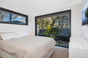 A bed or beds in a room at Bridgewater Retreat