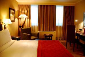 Un ou plusieurs lits dans un hébergement de l'établissement Southern Sun OR Tambo International Airport