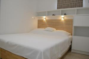 A bed or beds in a room at Villa I Karma