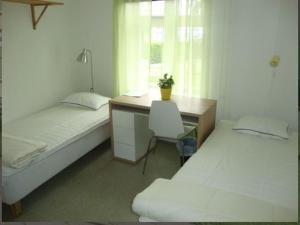 Ein Bett oder Betten in einem Zimmer der Unterkunft Kalmar Sjömanshem