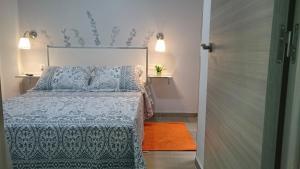 Cama o camas de una habitación en Casa alta del mar