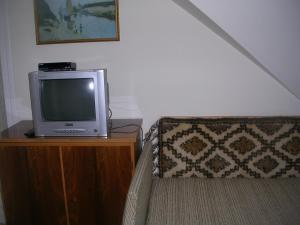 A television and/or entertainment center at Hegyesi Vendégház